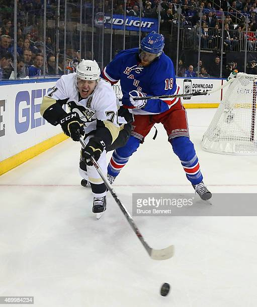 Evgeni Malkin of the Pittsburgh Penguins is checked by Marc Staal of the New York Rangers during the first period in Game One of the Eastern...