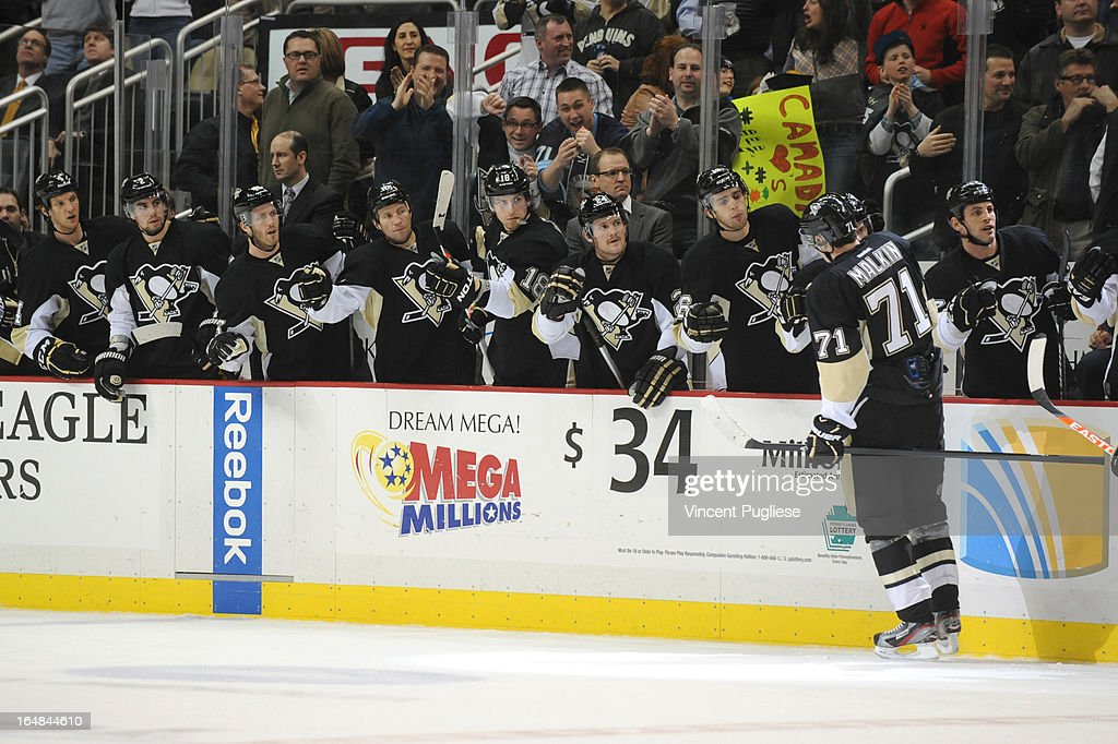 Evgeni Malkin #71 of the Pittsburgh Penguins is congratulated by teammates after his goal gave the Penguins a 2-0 lead over the Winnipeg Jets in the first period on February 28, 2013 at the CONSOL Energy Center in Pittsburgh, Pennsylvania.