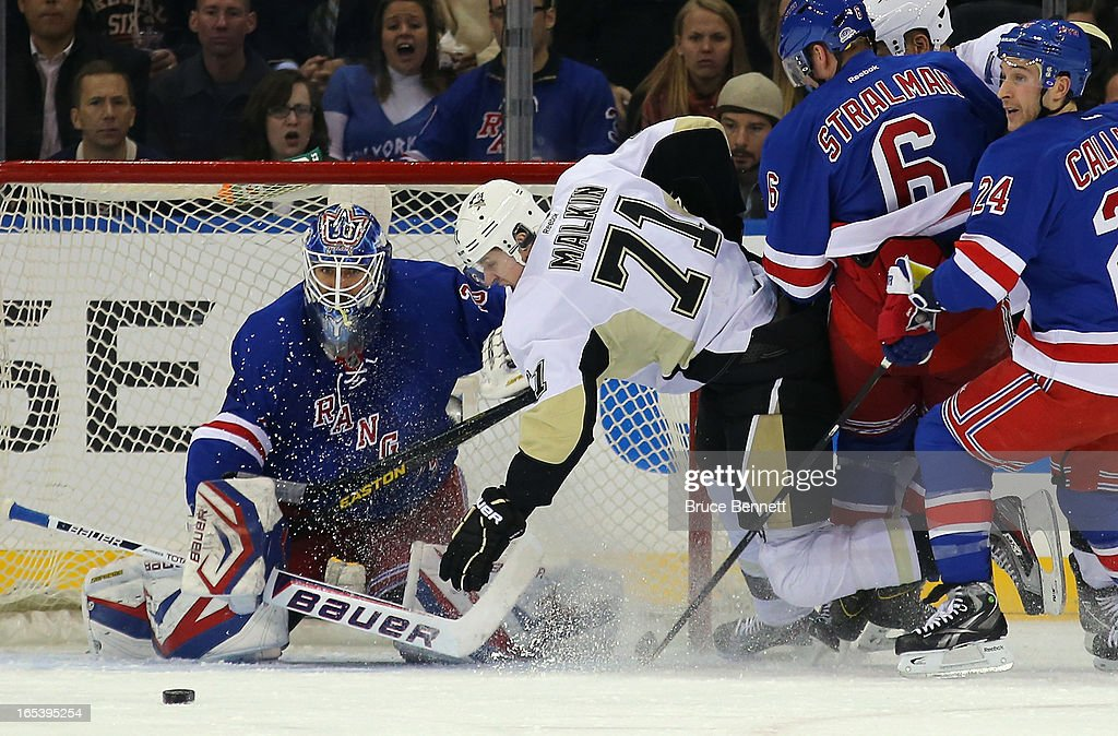 <a gi-track='captionPersonalityLinkClicked' href=/galleries/search?phrase=Evgeni+Malkin&family=editorial&specificpeople=221676 ng-click='$event.stopPropagation()'>Evgeni Malkin</a> #71 of the Pittsburgh Penguins is tripped up in front of <a gi-track='captionPersonalityLinkClicked' href=/galleries/search?phrase=Henrik+Lundqvist&family=editorial&specificpeople=217958 ng-click='$event.stopPropagation()'>Henrik Lundqvist</a> #30 of the New York Rangers at Madison Square Garden on April 3, 2013 in New York City.