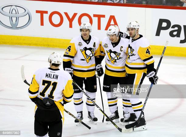 Evgeni Malkin of the Pittsburgh Penguins joins teammates Chris Kunitz Sidney Crosby and Justin Schultz to celebrate a second period goal against the...