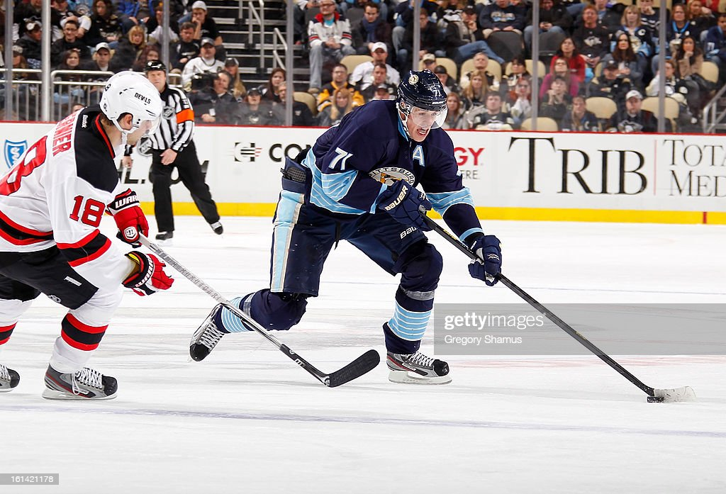 Evgeni Malkin #71 of the Pittsburgh Penguins moves the puck around the defense of <a gi-track='captionPersonalityLinkClicked' href=/galleries/search?phrase=Steve+Bernier&family=editorial&specificpeople=557040 ng-click='$event.stopPropagation()'>Steve Bernier</a> #18 of the New Jersey Devils on February 10, 2013 at Consol Energy Center in Pittsburgh, Pennsylvania. New Jersey won the game 3-1.