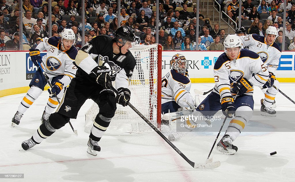 Evgeni Malkin #71 of the Pittsburgh Penguins moves the puck in front of the defense of <a gi-track='captionPersonalityLinkClicked' href=/galleries/search?phrase=Mark+Pysyk&family=editorial&specificpeople=6571526 ng-click='$event.stopPropagation()'>Mark Pysyk</a> #53 of the Buffalo Sabres on April 23, 2013 at Consol Energy Center in Pittsburgh, Pennsylvania.