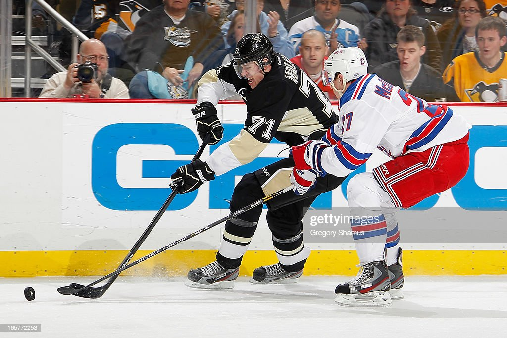 Evgeni Malkin #71 of the Pittsburgh Penguins moves the puck past the defense of <a gi-track='captionPersonalityLinkClicked' href=/galleries/search?phrase=Ryan+McDonagh&family=editorial&specificpeople=4324983 ng-click='$event.stopPropagation()'>Ryan McDonagh</a> #27 of the New York Rangers on April 5, 2013 at Consol Energy Center in Pittsburgh, Pennsylvania.