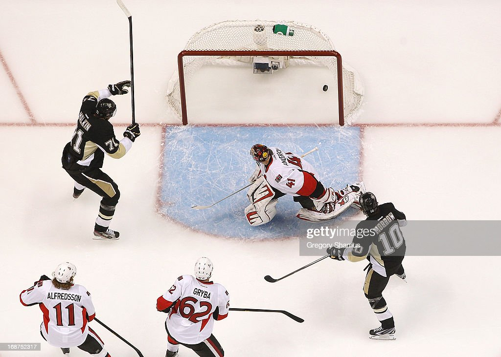 <a gi-track='captionPersonalityLinkClicked' href=/galleries/search?phrase=Evgeni+Malkin&family=editorial&specificpeople=221676 ng-click='$event.stopPropagation()'>Evgeni Malkin</a> #71 of the Pittsburgh Penguins reacts after his first period goal in front of <a gi-track='captionPersonalityLinkClicked' href=/galleries/search?phrase=Craig+Anderson&family=editorial&specificpeople=211238 ng-click='$event.stopPropagation()'>Craig Anderson</a> #41 of the Ottawa Senators in Game One of the Eastern Conference Semifinals during the 2013 NHL Stanley Cup Playoffs at Consol Energy Center on May 14, 2013 in Pittsburgh, Pennsylvania.