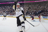 Evgeni Malkin of the Pittsburgh Penguins reacts after scoring a hattrick goal during the second period in Game Six of the First Round of the 2014...