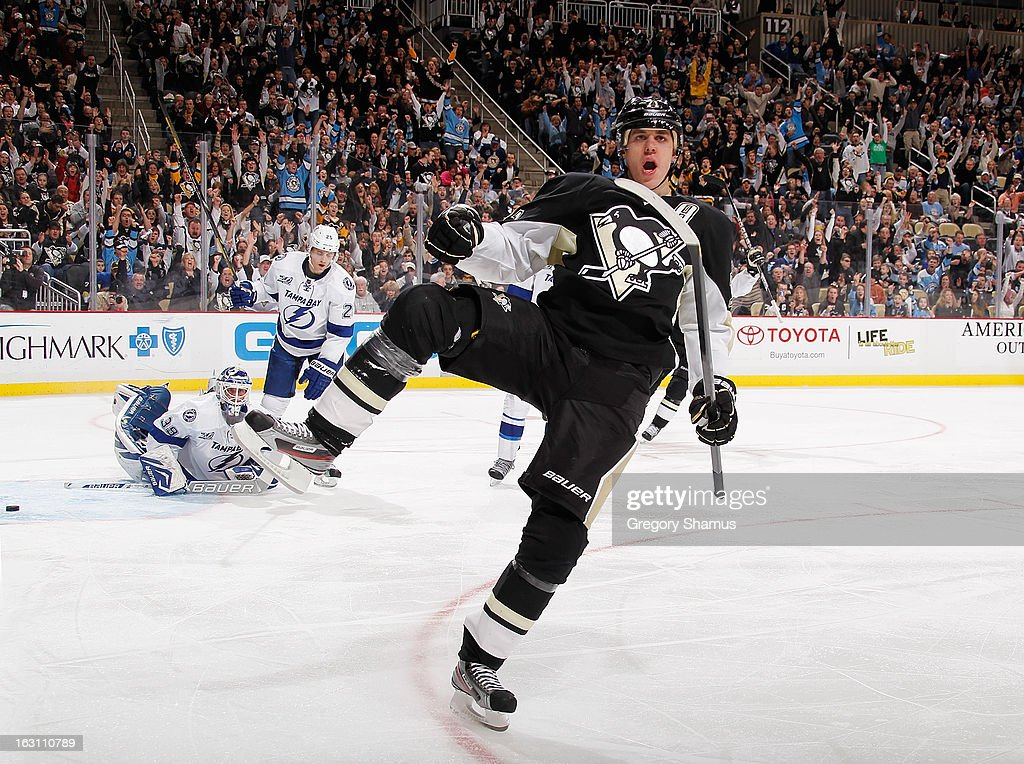 Evgeni Malkin #71 of the Pittsburgh Penguins reacts to his third period goal in front of Anders Lindback #39 and <a gi-track='captionPersonalityLinkClicked' href=/galleries/search?phrase=Eric+Brewer&family=editorial&specificpeople=202144 ng-click='$event.stopPropagation()'>Eric Brewer</a> #2 of the Tampa Bay Lightning on March 4, 2013 at Consol Energy Center in Pittsburgh, Pennsylvania. Pittsburgh won the game 4-3