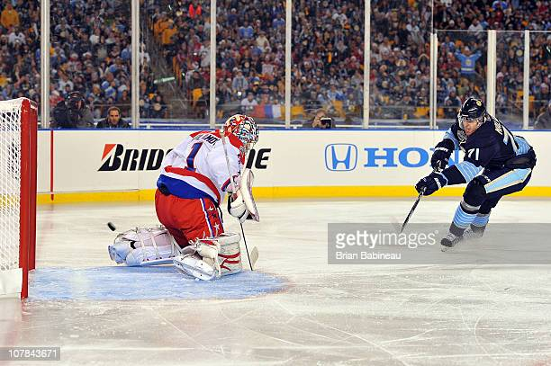 Evgeni Malkin of the Pittsburgh Penguins scores a goal against Semyon Varlamov of the Washington Capitals in the 2nd period during the 2011 NHL...