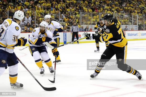 Evgeni Malkin of the Pittsburgh Penguins scores his team's third goal in the first period against Viktor Arvidsson and Yannick Weber of the Nashville...