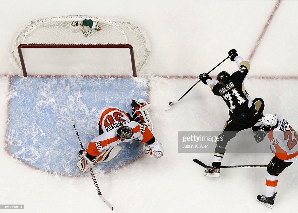 Evgeni Malkin #71 of the Pittsburgh Penguins scores past Ilya Bryzgalov #30 of the Philadelphia Flyers during the game at Consol Energy Center on February 20, 2013 in Pittsburgh, Pennsylvania. The Flyers defeated the Penguins 6-5.