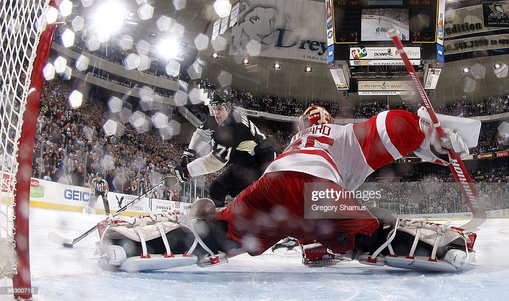 Evgeni Malkin of the Pittsburgh Penguins scores the game winning shootout goal against Jimmy Howard of the Detroit Red Wings on January 31 2010 at...