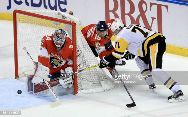Evgeni Malkin of the Pittsburgh Penguins shoots on James Reimer of the Florida Panthers during a game at BBT Center on October 20 2017 in Sunrise...