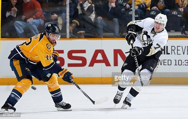Evgeni Malkin of the Pittsburgh Penguins skates against Mike Fisher of the Nashville Predators at Bridgestone Arena on March 4 2014 in Nashville...
