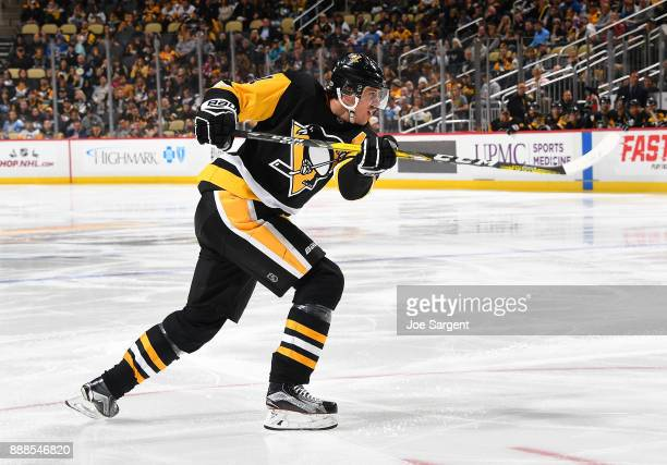 Evgeni Malkin of the Pittsburgh Penguins skates against the Buffalo Sabres at PPG Paints Arena on December 2 2017 in Pittsburgh Pennsylvania
