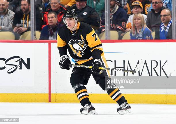 Evgeni Malkin of the Pittsburgh Penguins skates against the New York Rangers at PPG Paints Arena on December 5 2017 in Pittsburgh Pennsylvania