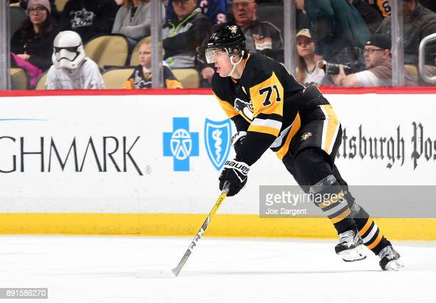 Evgeni Malkin of the Pittsburgh Penguins skates against the New York Islanders at PPG Paints Arena on December 7 2017 in Pittsburgh Pennsylvania
