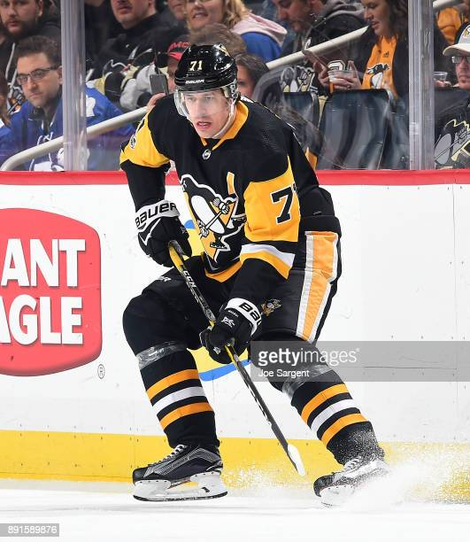 Evgeni Malkin of the Pittsburgh Penguins skates against the Toronto Maple Leafs at PPG Paints Arena on December 9 2017 in Pittsburgh Pennsylvania