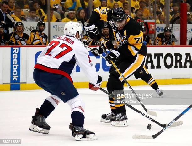 Evgeni Malkin of the Pittsburgh Penguins skates against TJ Oshie of the Washington Capitals in Game Six of the Eastern Conference Second Round during...
