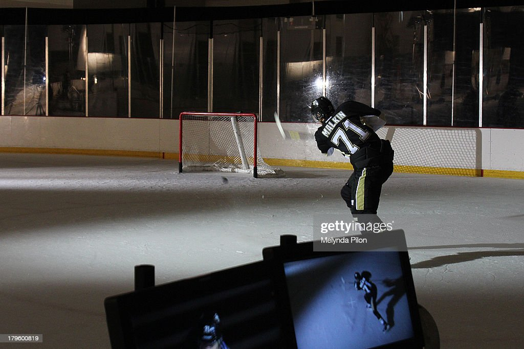 <a gi-track='captionPersonalityLinkClicked' href=/galleries/search?phrase=Evgeni+Malkin&family=editorial&specificpeople=221676 ng-click='$event.stopPropagation()'>Evgeni Malkin</a> of the Pittsburgh Penguins skates on the ice during a production shoot at the 2013 NHL Player Media Tour at the Prudential Center on September 5, 2013 in Newark, New Jersey.