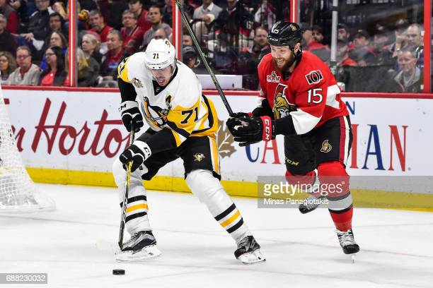Evgeni Malkin of the Pittsburgh Penguins skates the puck against Zack Smith of the Ottawa Senators in Game Six of the Eastern Conference Final during...