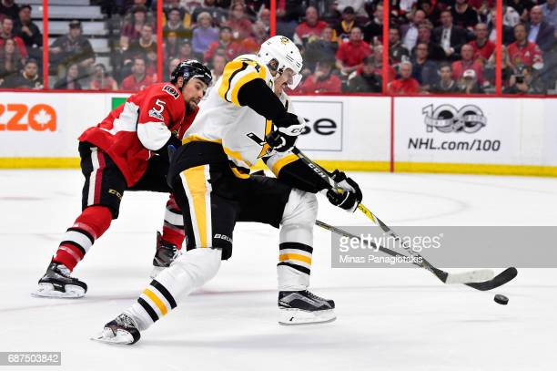 Evgeni Malkin of the Pittsburgh Penguins skates with the puck against Marc Methot of the Ottawa Senators during the second period in Game Six of the...