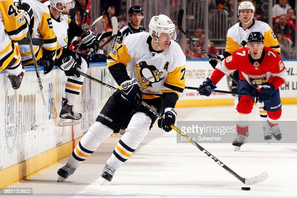 Evgeni Malkin of the Pittsburgh Penguins skates with the puck against the Florida Panthers at the BBT Center on October 20 2017 in Sunrise Florida
