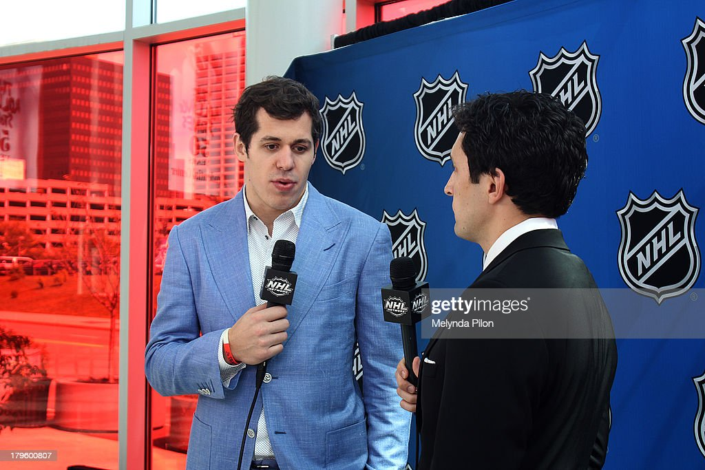 <a gi-track='captionPersonalityLinkClicked' href=/galleries/search?phrase=Evgeni+Malkin&family=editorial&specificpeople=221676 ng-click='$event.stopPropagation()'>Evgeni Malkin</a> of the Pittsburgh Penguins speaks with Steve Mears during a NHL Network interview at the 2013 NHL Player Media Tour at the Prudential Center on September 5, 2013 in Newark, New Jersey.