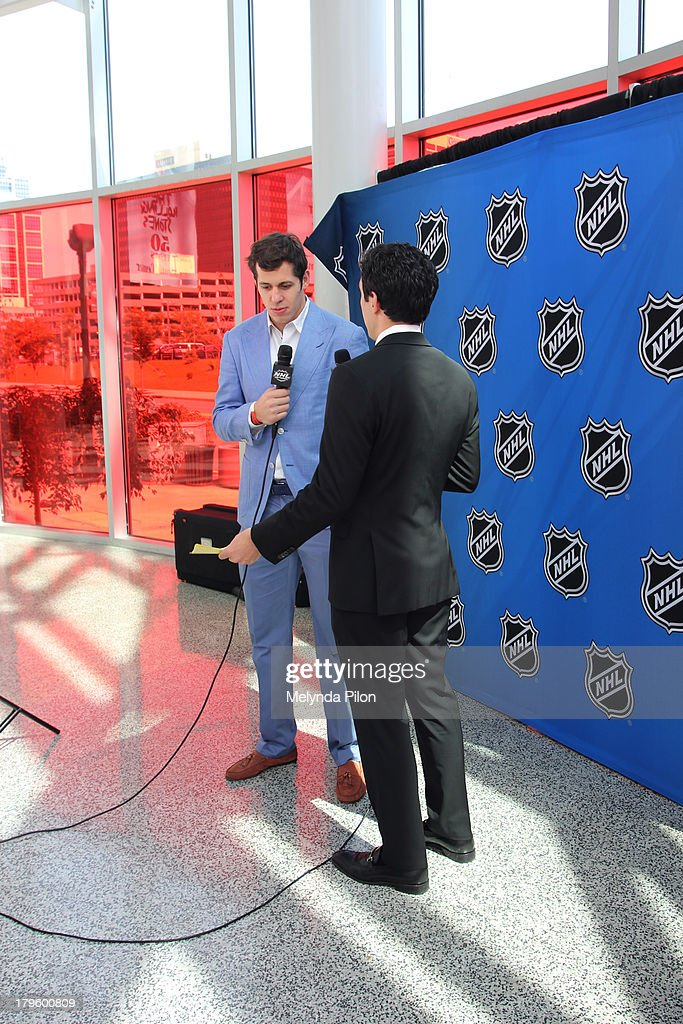 Evgeni Malkin of the Pittsburgh Penguins speaks with Steve Mears during a NHL Network interview at the 2013 NHL Player Media Tour at the Prudential Center on September 5, 2013 in Newark, New Jersey.