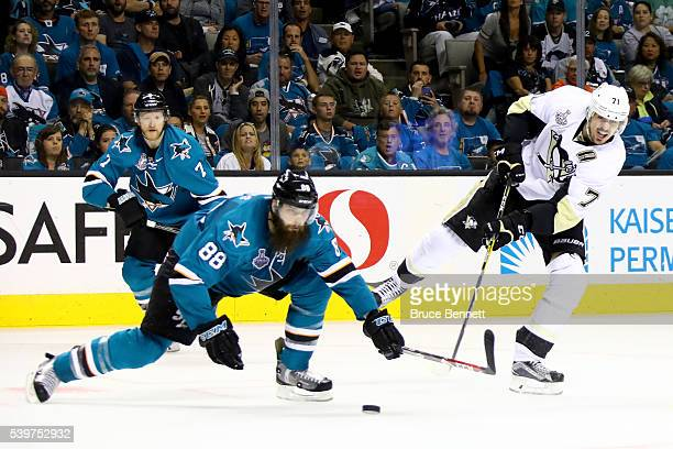 Evgeni Malkin of the Pittsburgh Penguins takes a shot against Brent Burns of the San Jose Sharks in Game Six of the 2016 NHL Stanley Cup Final at SAP...