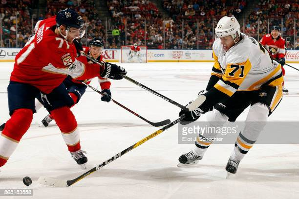 Evgeni Malkin of the Pittsburgh Penguins tangles with Radim Vrbata of the Florida Panthers at the BBT Center on October 20 2017 in Sunrise Florida