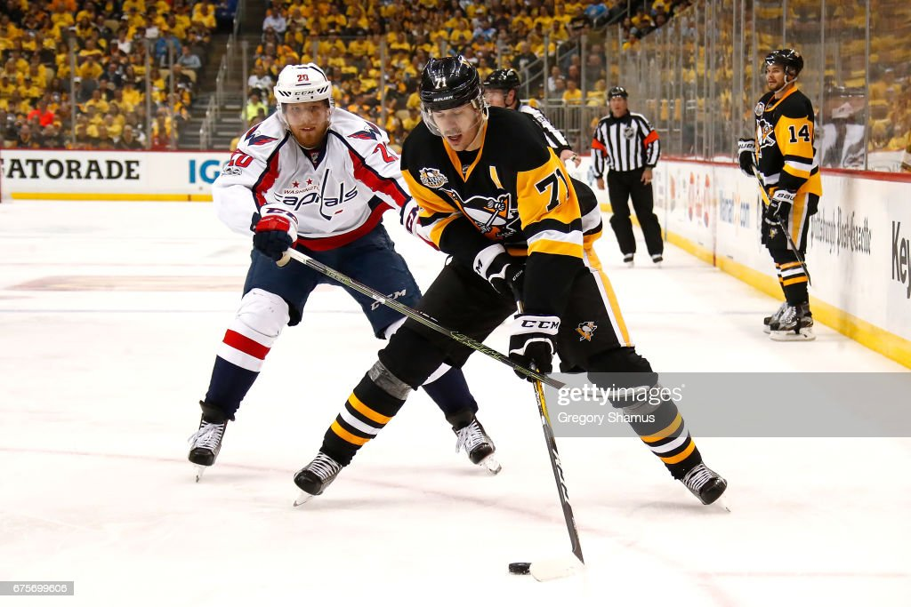 Evgeni Malkin #71 of the Pittsburgh Penguins tries to avoid the stick of Lars Eller #20 of the Washington Capitals during the second period in Game Three of the Eastern Conference Second Round during the 2017 NHL Stanley Cup Playoffs at PPG Paints Arena on May 1, 2017 in Pittsburgh, Pennsylvania.