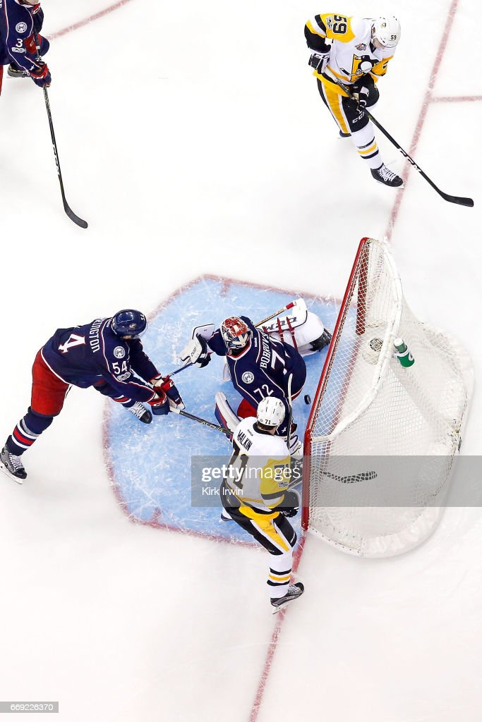 Evgeni Malkin #71 of the Pittsburgh Penguins watches as teammate Jake Guentzel #59 beats Sergei Bobrovsky #72 of the Columbus Blue Jackets for a goal during the third period of Game Three of the Eastern Conference First Round during the 2017 NHL Stanley Cup Playoffs on April 16, 2017 at Nationwide Arena in Columbus, Ohio. Pittsburgh defeated Columbus 5-4 in overtime. Pittsburgh leads the series 3-0.