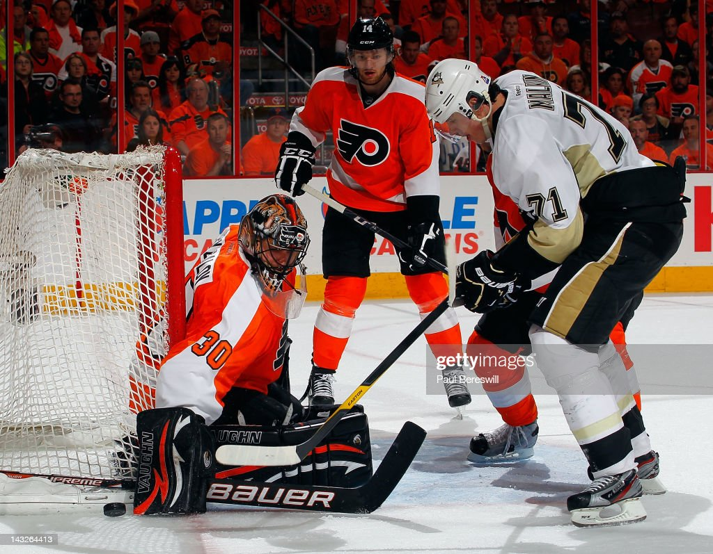 Evgeni Malkin #71 of the Pittsburgh Penguins watches his shot get stopped by Flyers goalie Ilya Bryzgalov #30 while Flyers Sean Couturier #14 stands by in the background in the third period of Game Six of the Eastern Conference Quarterfinals during the 2012 NHL Stanley Cup Playoffs at Wells Fargo Center on April 22, 2012 in Philadelphia, Pennsylvania. Flyers won the game 5-1 to eliminate the Penguins from the playoffs
