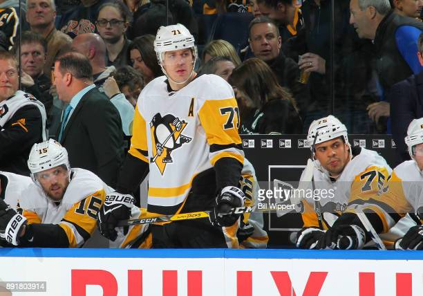 Evgeni Malkin of the Pittsburgh Penguins watches the action against the Buffalo Sabres during an NHL game on December 1 2017 at KeyBank Center in...