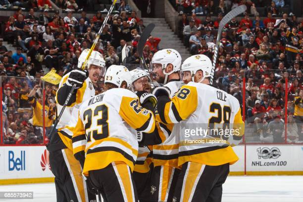 Evgeni Malkin Scott Wilson Ian Cole Phil Kessel and Brian Dumoulin of the Pittsburgh Penguins celebrate a goal against the Ottawa Senators in Game...