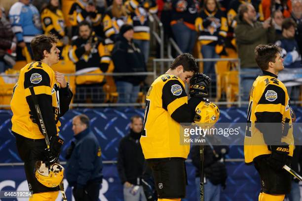 Evgeni Malkin Sidney Crosby and Chris Kunitz all of the Pittsburgh Penguins listen to the national anthem prior to the start of the game against the...