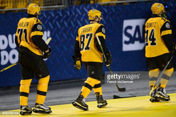 Evgeni Malkin Sidney Crosby and Chris Kunitz of the Pittsburgh Penguins walk to the locker room after the Penguins defeated the Flyers 42 in the 2017...