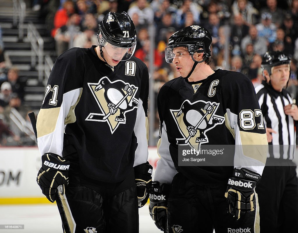 Evgeni Malkin #71 talks with Sidney Crosby #87 of the Pittsburgh Penguins during the game against the Ottawa Senators on February 13, 2013 at Consol Energy Center in Pittsburgh, Pennsylvania.