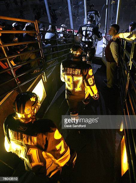 Evgeni MalkinSidney Crosby and Ryan Malone all of the Pittsburgh Penguins take to the ice to face the New York Rangers during their NHL game at...