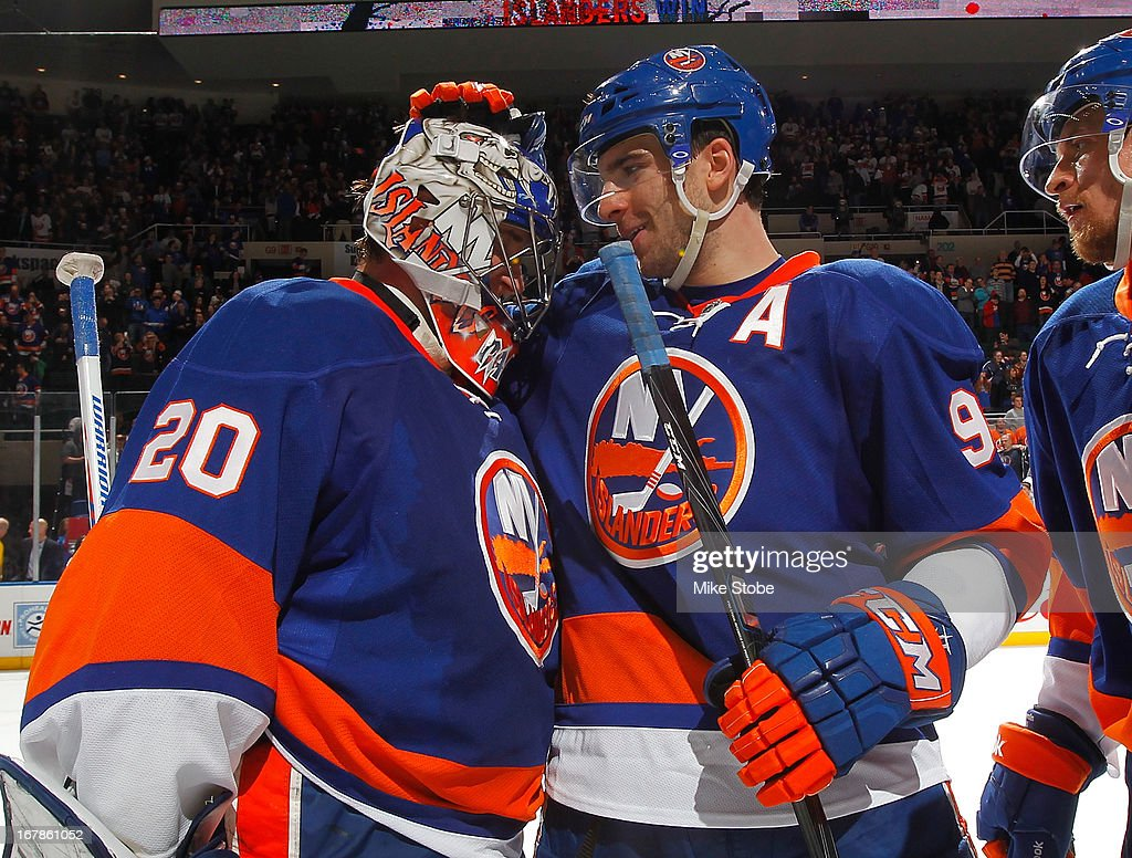 Evgeni Nabokov #20 of the New York Islanders and John Tavares #91 celebrate after defeating the Florida Panthers at Nassau Veterans Memorial Coliseum on April 16, 2013 in Uniondale, New York.