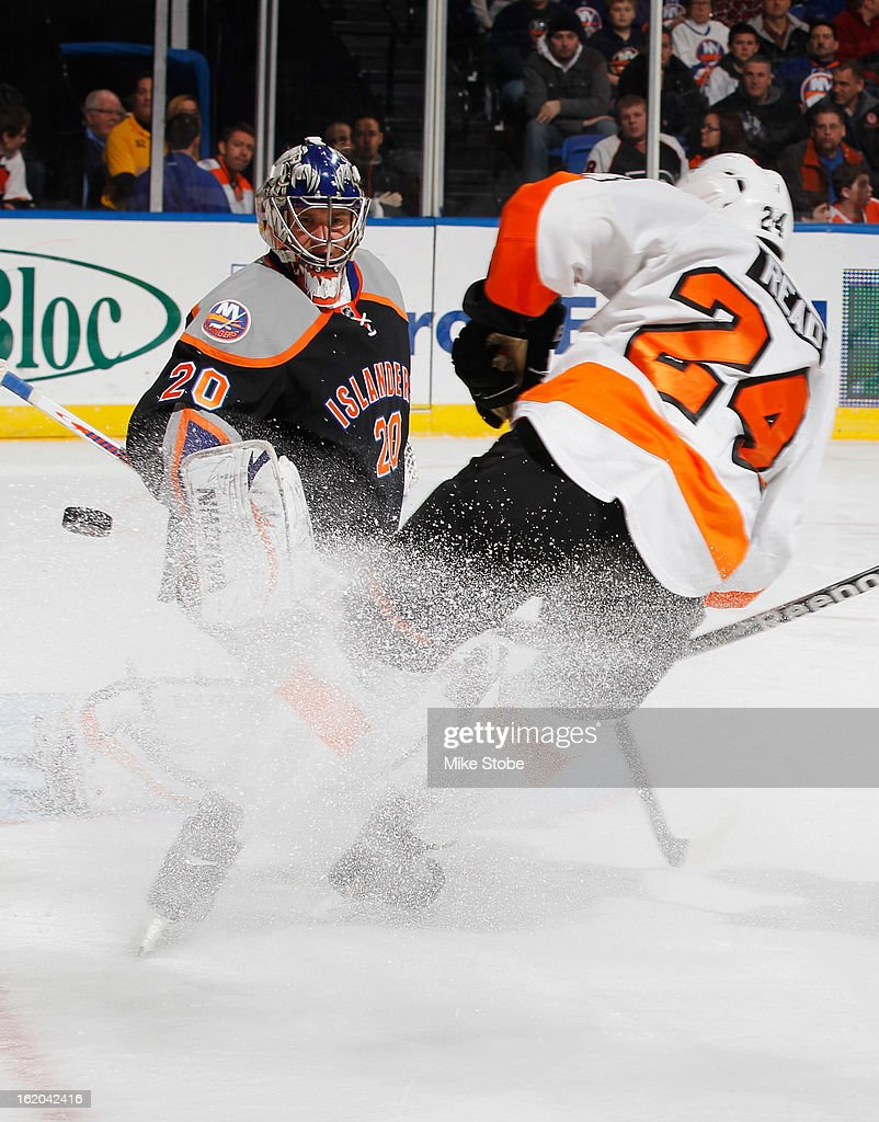 Evgeni Nabokov #20 of the New York Islanders defends against Matt Read #24 of the Philadelphia Flyers at Nassau Veterans Memorial Coliseum on February 18, 2013 in Uniondale, New York.