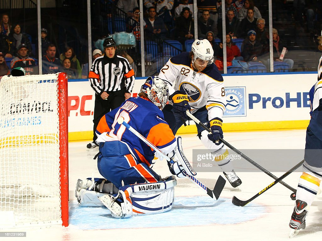 Evgeni Nabokov #20 of the New York Islanders defends the net against Marcus Foligno #82 of the Buffalo Sabres during their game at Nassau Veterans Memorial Coliseum on February 9, 2013 in Uniondale, New York.