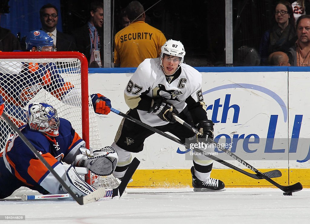 Evgeni Nabokov #20 of the New York Islanders defends the net against Sidney Crosby #87 of the Pittsburgh Penguins during the second period at Nassau Veterans Memorial Coliseum on March 22, 2013 in Uniondale, New York.