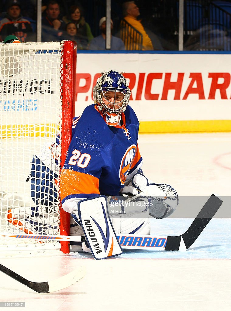 Evgeni Nabokov #20 of the New York Islanders in action against the Buffalo Sabres during their game at Nassau Veterans Memorial Coliseum on February 9, 2013 in Uniondale, New York.