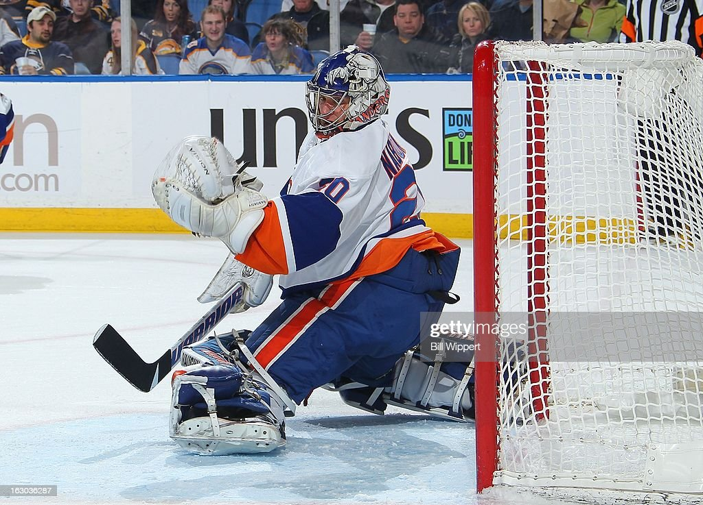 Evgeni Nabokov #20 of the New York Islanders makes a save against the Buffalo Sabres on February 23, 2013 at the First Niagara Center in Buffalo, New York.