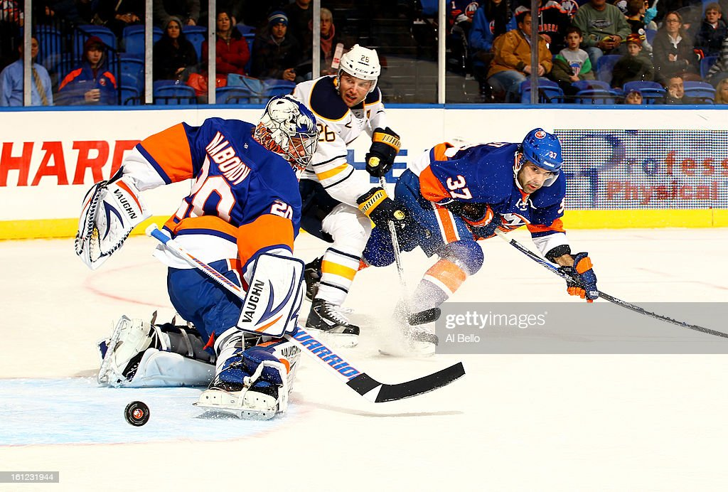 Evgeni Nabokov #20 of the New York Islanders makes a save against Thomas Vanek #26 of the Buffalo Sabres during their game at Nassau Veterans Memorial Coliseum on February 9, 2013 in Uniondale, New York.