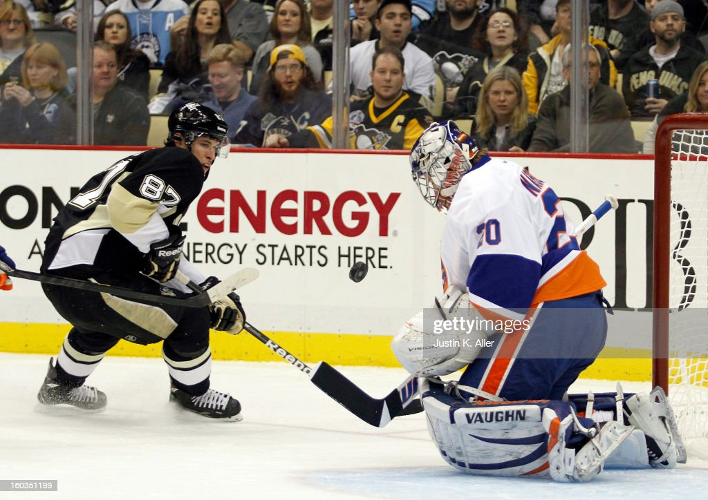 Evgeni Nabokov #20 of the New York Islanders makes a save in front of Sidney Crosby #87 of the Pittsburgh Penguins during the game at Consol Energy Center on January 29, 2013 in Pittsburgh, Pennsylvania.