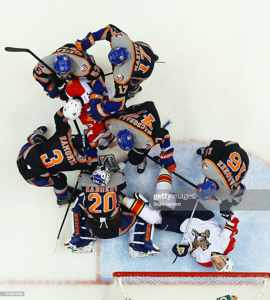 Evgeni Nabokov #20 of the New York Islanders makes the save against the Florida Panthers during the his 3-0 shutout against the Panthers at the Nassau Veterans Memorial Coliseum on March 24, 2013 in Uniondale, New York.