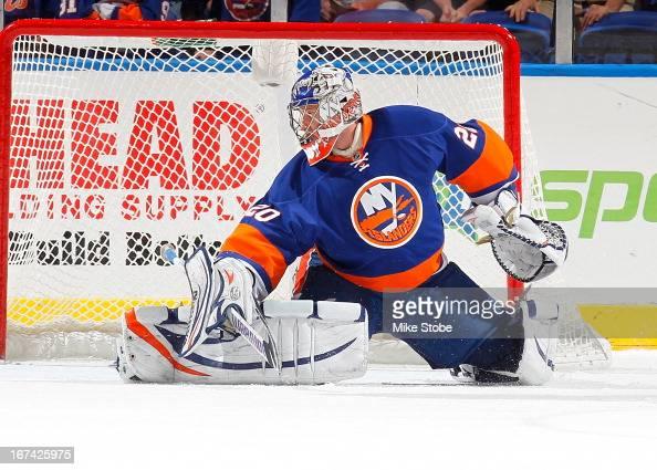 Evgeni Nabokov of the New York Islanders skates against the Philadelphia Flyers at Nassau Veterans Memorial Coliseum on April 9 2013 in Uniondale New...
