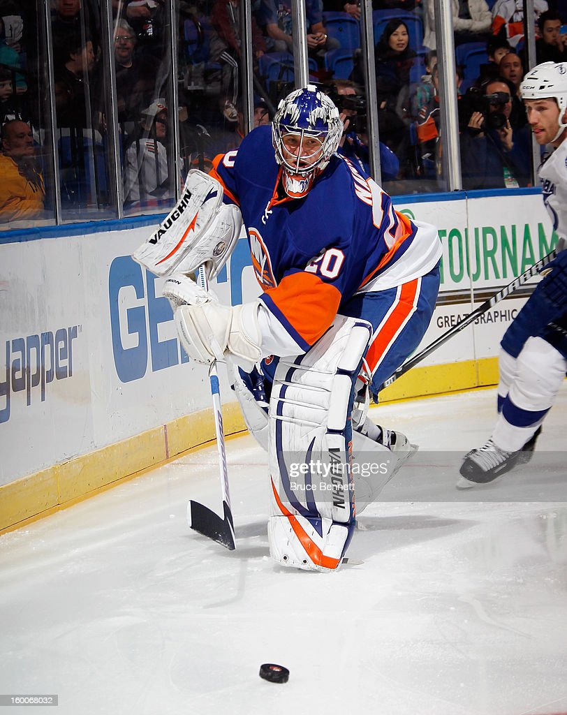 Evgeni Nabokov #20 of the New York Islanders skates against the Tampa Bay Lightning at the Nassau Veterans Memorial Coliseum on January 21, 2013 in Uniondale, New York.
