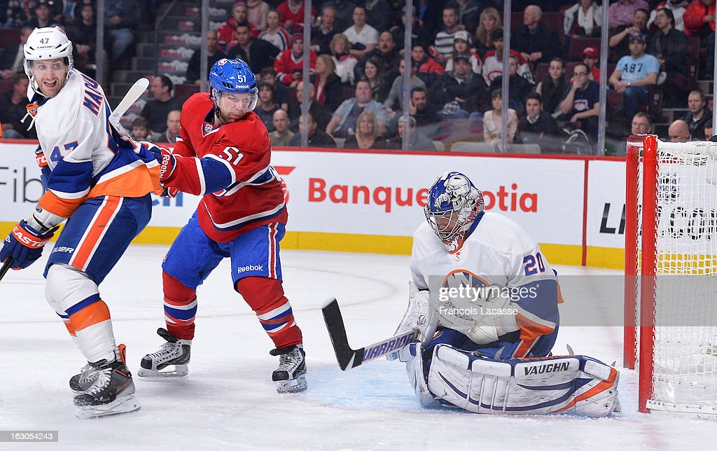 Evgeni Nabokov #20 of the New York Islanders stops a shot by David Desharnais #51of the Montreal Canadiens during an NHL game on February 21, 2013 at the Bell Centre in Montreal, Quebec, Canada. (Photo by Francois Lacasse/NHLI via Getty Images) Evgeni Nabokov;David Desharnais;Andrew MacDonald